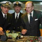 Daily Echo: ON THE BRIDGE: The Duke of Edinburgh with Captain Paul Wright and chief engineer Brian Whattling, during his tour of the QM2 ten years ago.