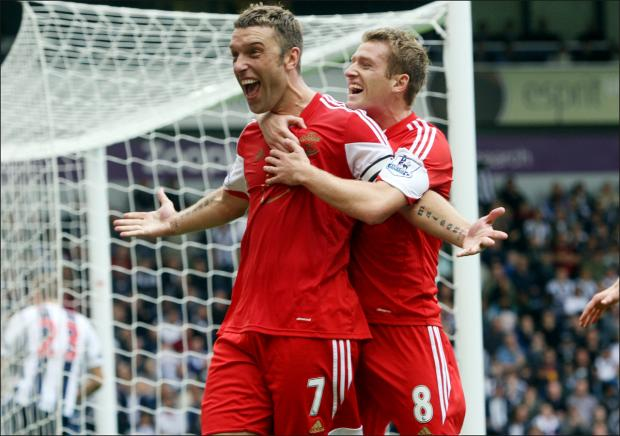 Daily Echo: Rickie Lambert's goals have helped Saints bank £15.6m for finishing eighth in the Premier League