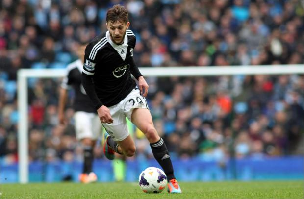 Daily Echo: Adam Lallana on the ball at the Etihad Stadium