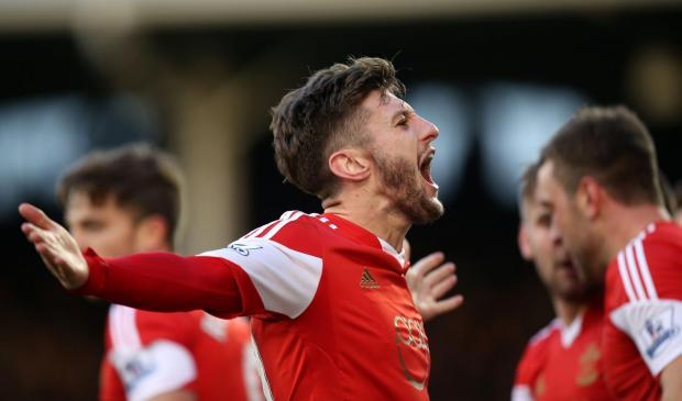 Daily Echo: Adam Lallana celebrates at Craven Cottage