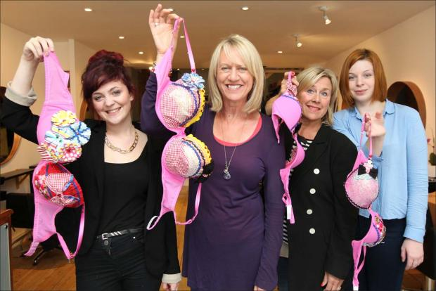 Sally Taylor with staff from Pure Hair and her specially decorated bra to wear in tomorrow's London Moonwalk.
