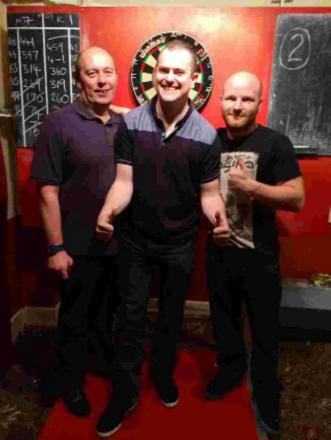 Runaway leader Martin Stead underlined his top position in the Southampton Darts Series with victory in the men's play-offs. Stead is pictured, right, with runner-up Kevin Woodward, left, and even organiser Stefan Evrard.