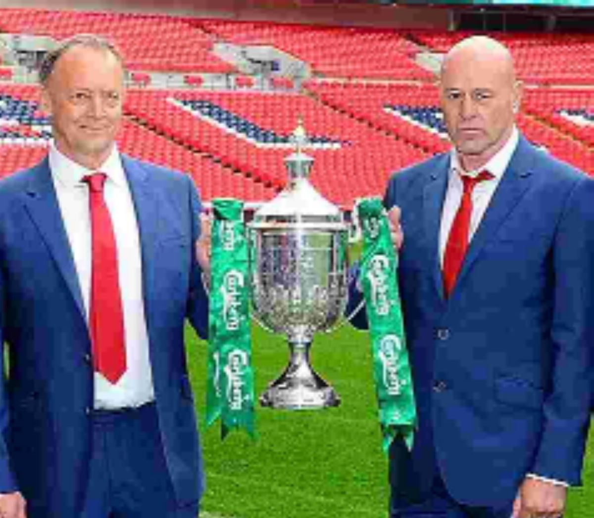 Dave Diaper, left, and Mick Brown get their hands on the FA Vase.