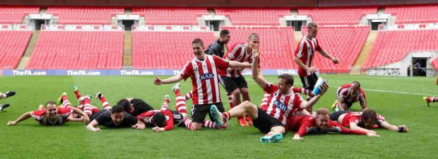 Sholing celebrate with a Wembley dive.
