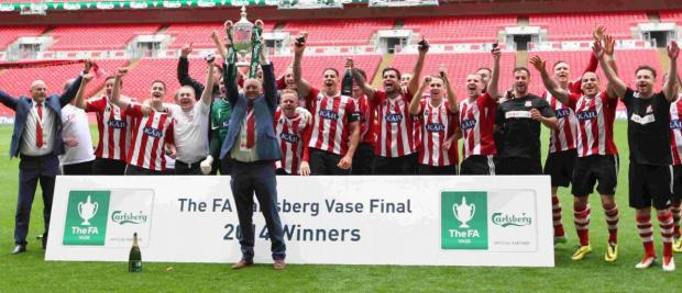 Dave Diaper lifts the FA Vase.