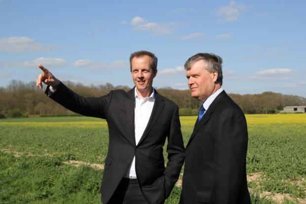 Daily Echo: Planning minister Nick Boles, left,  with Fareham Council leader Sean Woodward at the Welborne site.