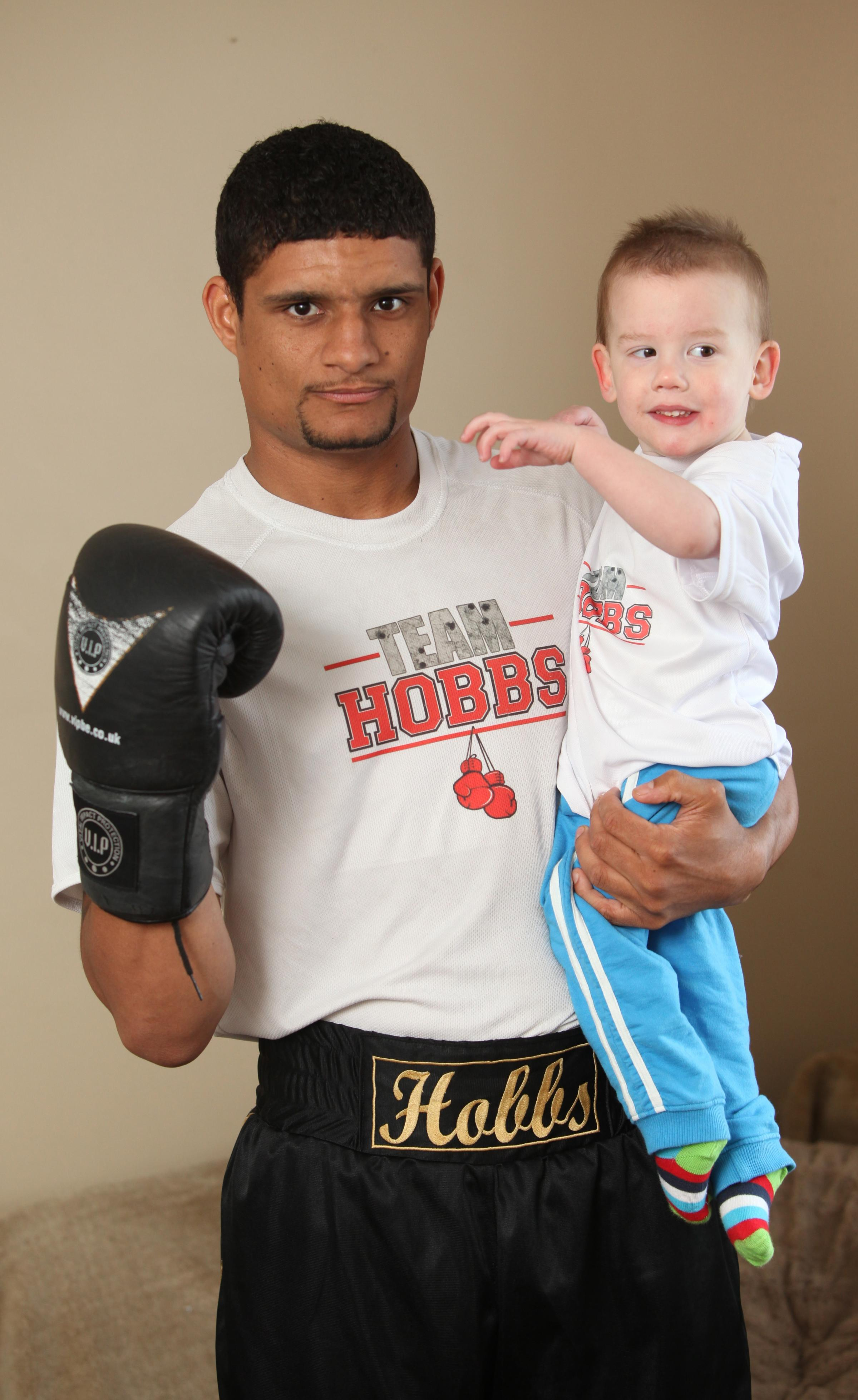 Boxer weighs in to help toddler