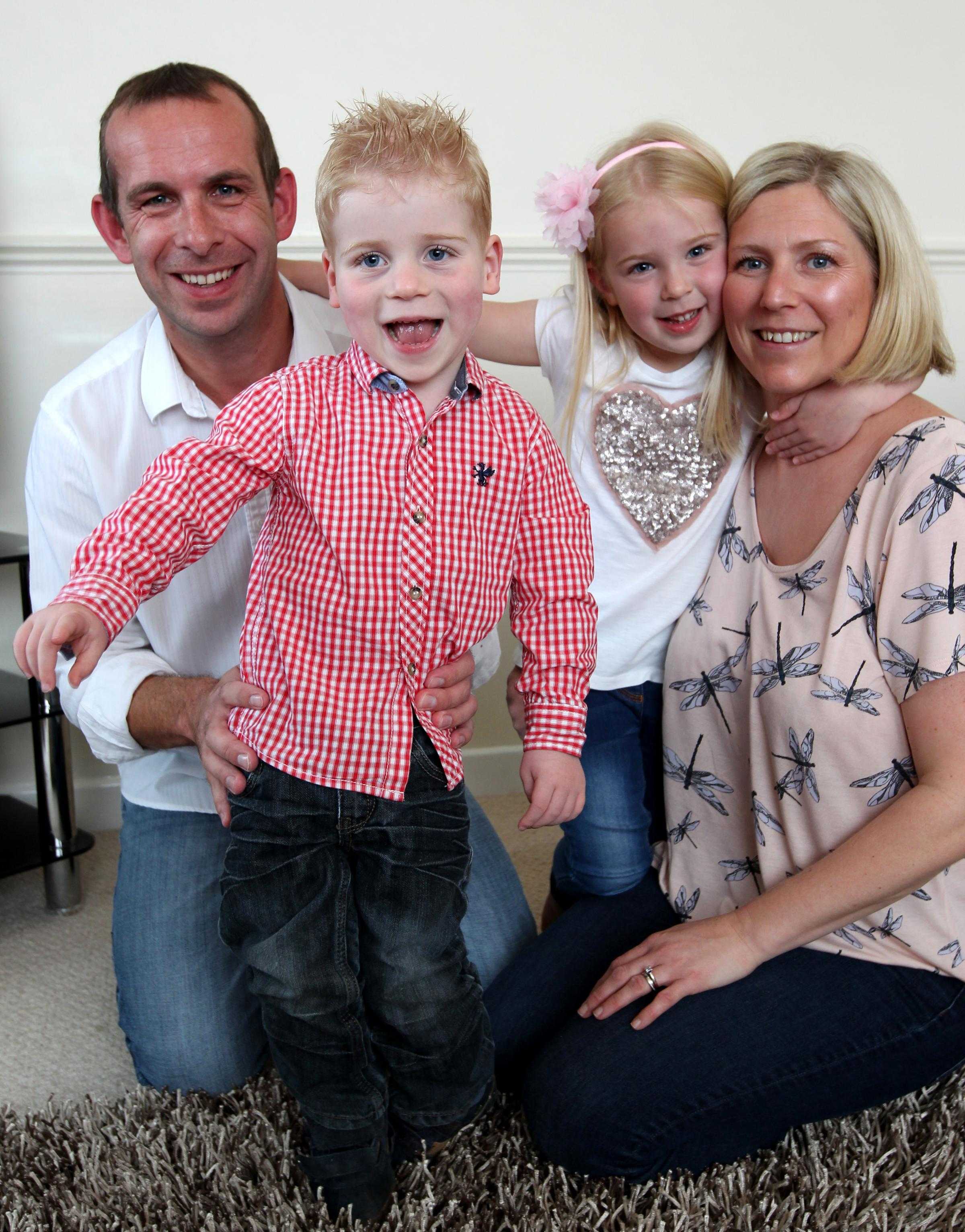 (L-r) Terry, Oliver, three, Millie, five and Sallyanne Osborne are trying to raise £100,000 to help Oliver walk unaided