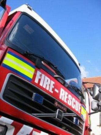 Firefighters battle shooting lodge blaze