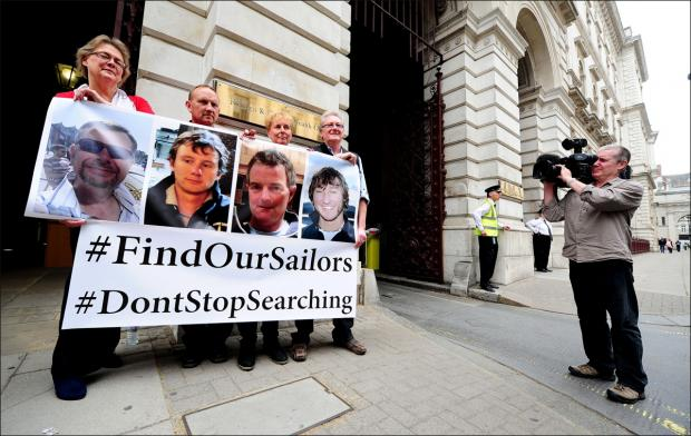 Families of the missing sailors in London today.