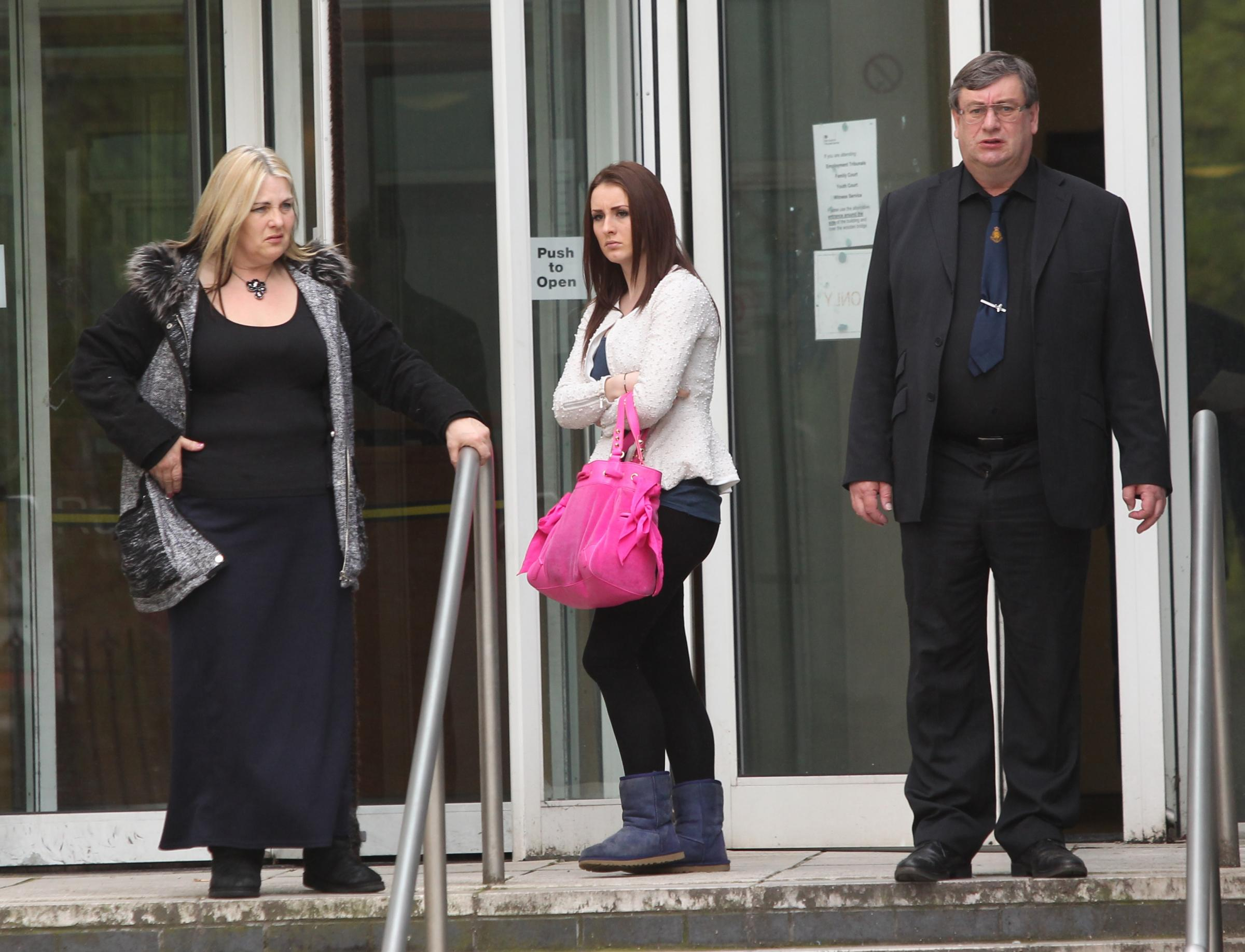 The Moss family: Michael and Elaine Moss with Lucia Moss outside court
