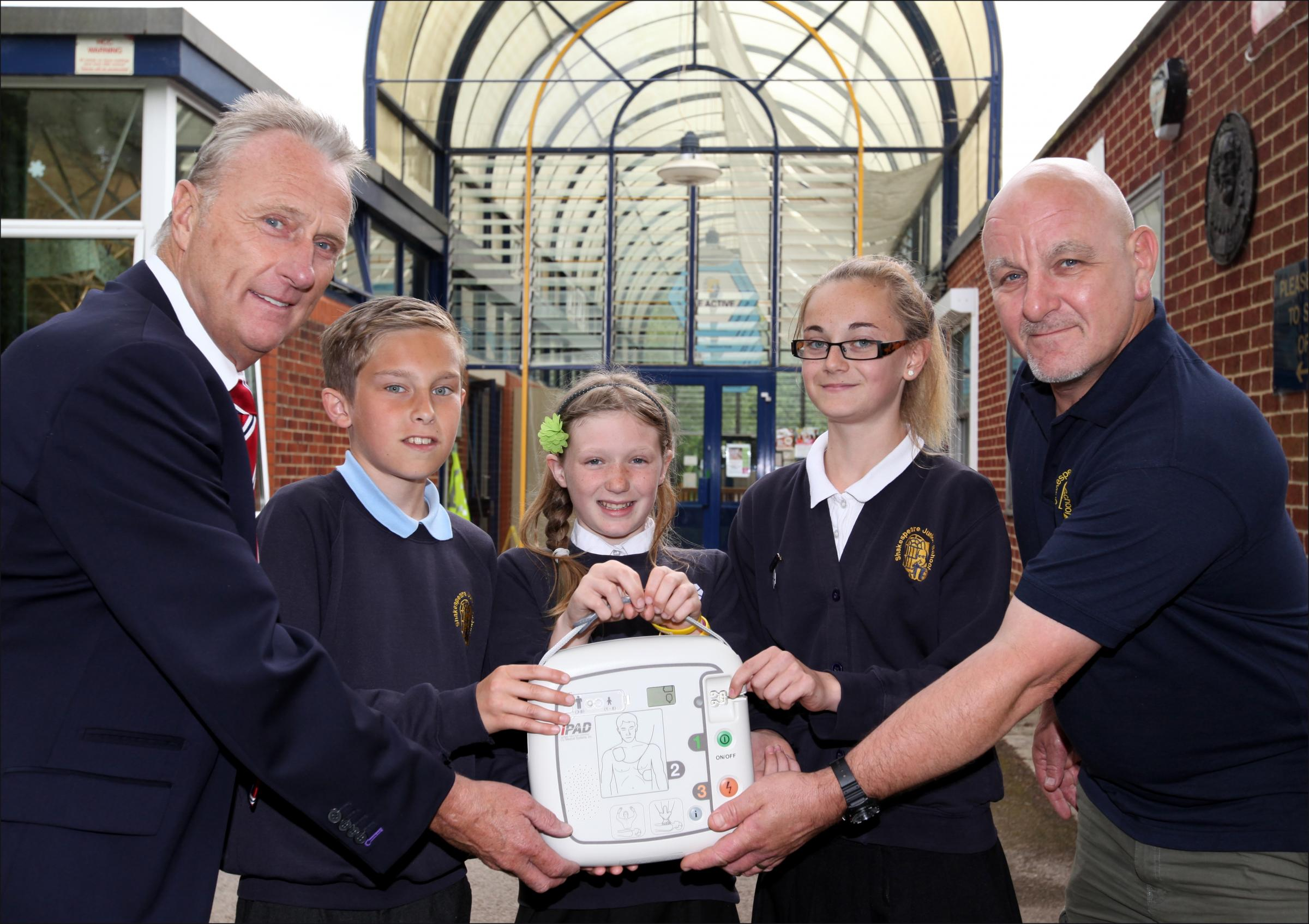 Stuart Deas of HP Contracts, pupils Benjamin Wyatt, Isobel Oram and Annalise Potter with school site manager John Troke
