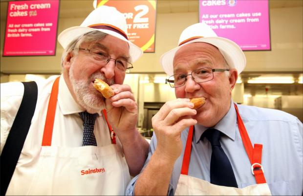 Daily Echo: The Mayors of Southampton and Eastleigh, Cllr Ivan White and Cllr Malcolm Cross, enjoy a tasting at the in-store bakery at Sainsbury's, Hedge End.