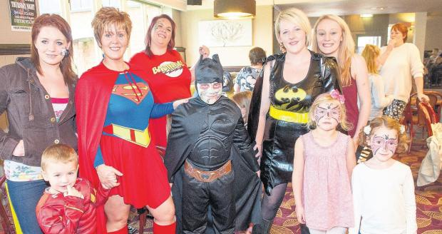 SUPER DAY: The Arrow Pub hosted a fun day organised by Claire Goddard (Batgirl) to raise money for her son Tai (Batman), who is taking part in the Transplant Games. Echo picture by James Newell. Order no: 18541291