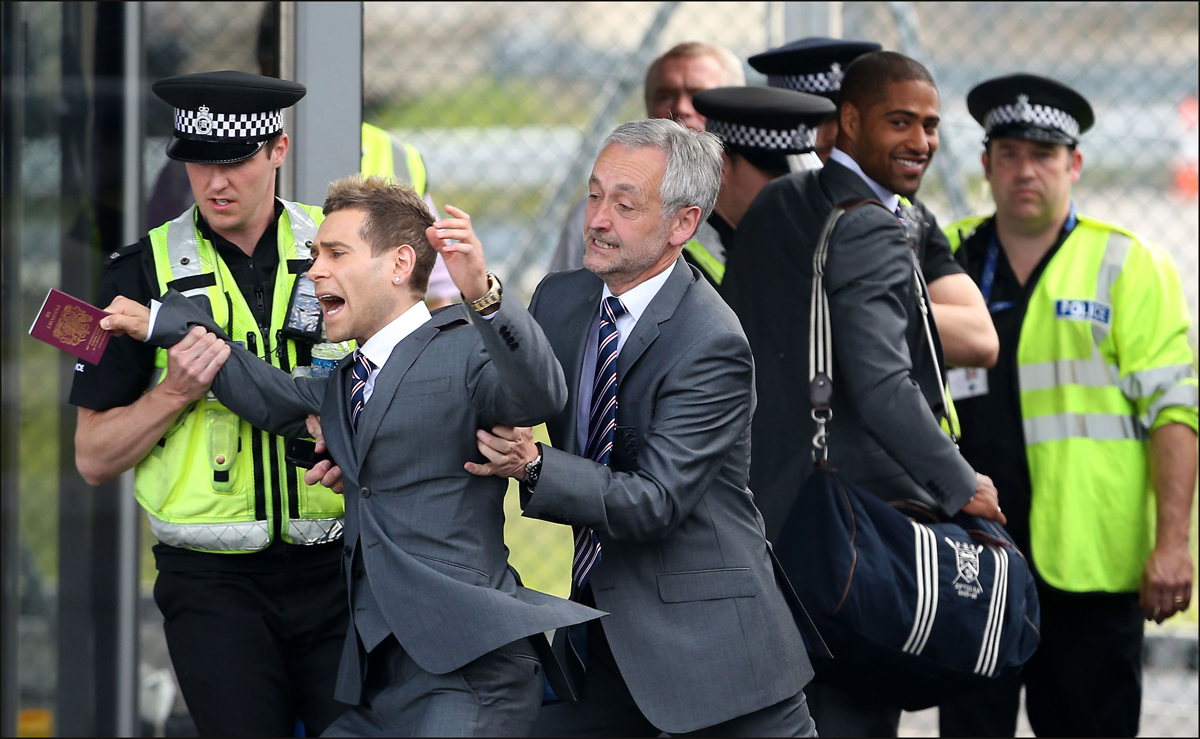 Comedian Simon Brodkin aka Lee Nelson is moved away from the England party.