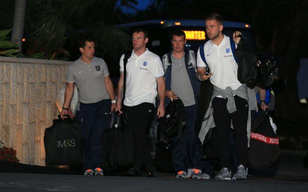 Daily Echo: Luke Shaw, right, arrives in Miami with the rest of the England squad this morning.