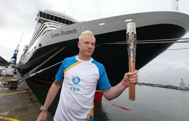 Iwan Thomas with the Queen's Baton at Queenn Elizabeth in Southampton