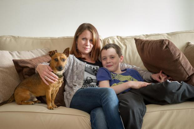 Daily Echo: Marie-Claire Pettyman with son Dylan and dog Busby.