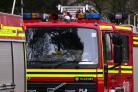 Fire crews battle bin lorry blaze