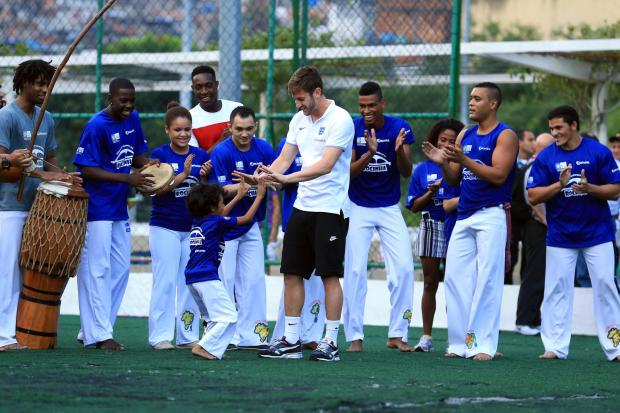 Daily Echo: Saints captain Adam Lallana dances with Brazilian children