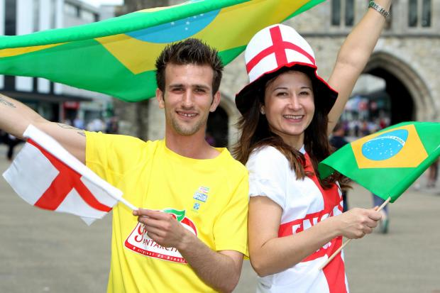 (L-r) Elton Viera Pita and Edyta Nicpon of Samba Bar and Grill celebrate the potential World Cup cash boost