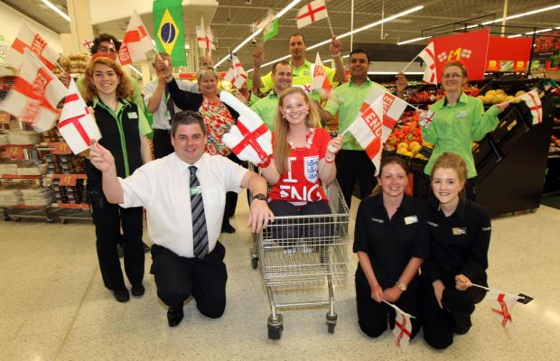 Daily Echo: The Daily Echo's number one England fan Emily Ford gearing up for the World Cup with Asda staff in Southampton