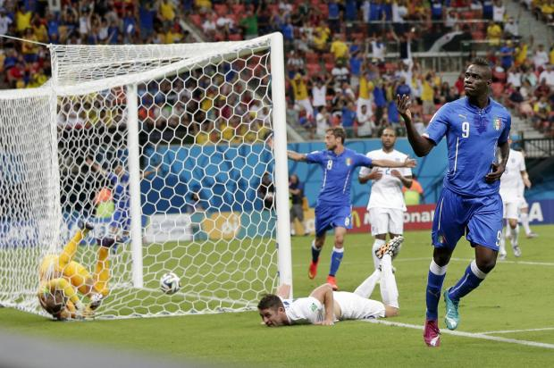 Daily Echo: Italy's Mario Balotelli (9) celebrates after scoring the match-winner
