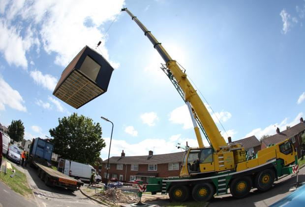 A 60-tonne crane lifts the modular adaptation pod (MAP)