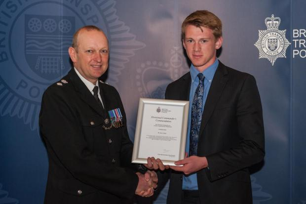 Jack Borbett receives his award from Chief Supt Paul Brogden