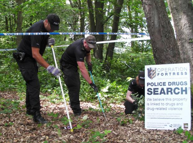 Arrests as police continue to search woodland