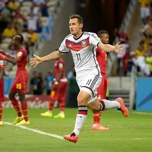 Daily Echo: Miroslav Klose rescued a point 20 minutes from time for Germany