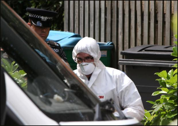 Police step up probe into woman's body found among bins