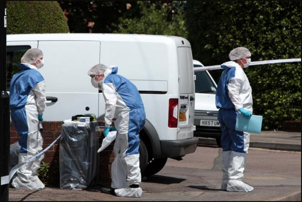 Daily Echo: Forensic officers search the scene