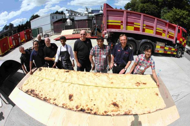 Firefighters and chefs with their trial run naan bread