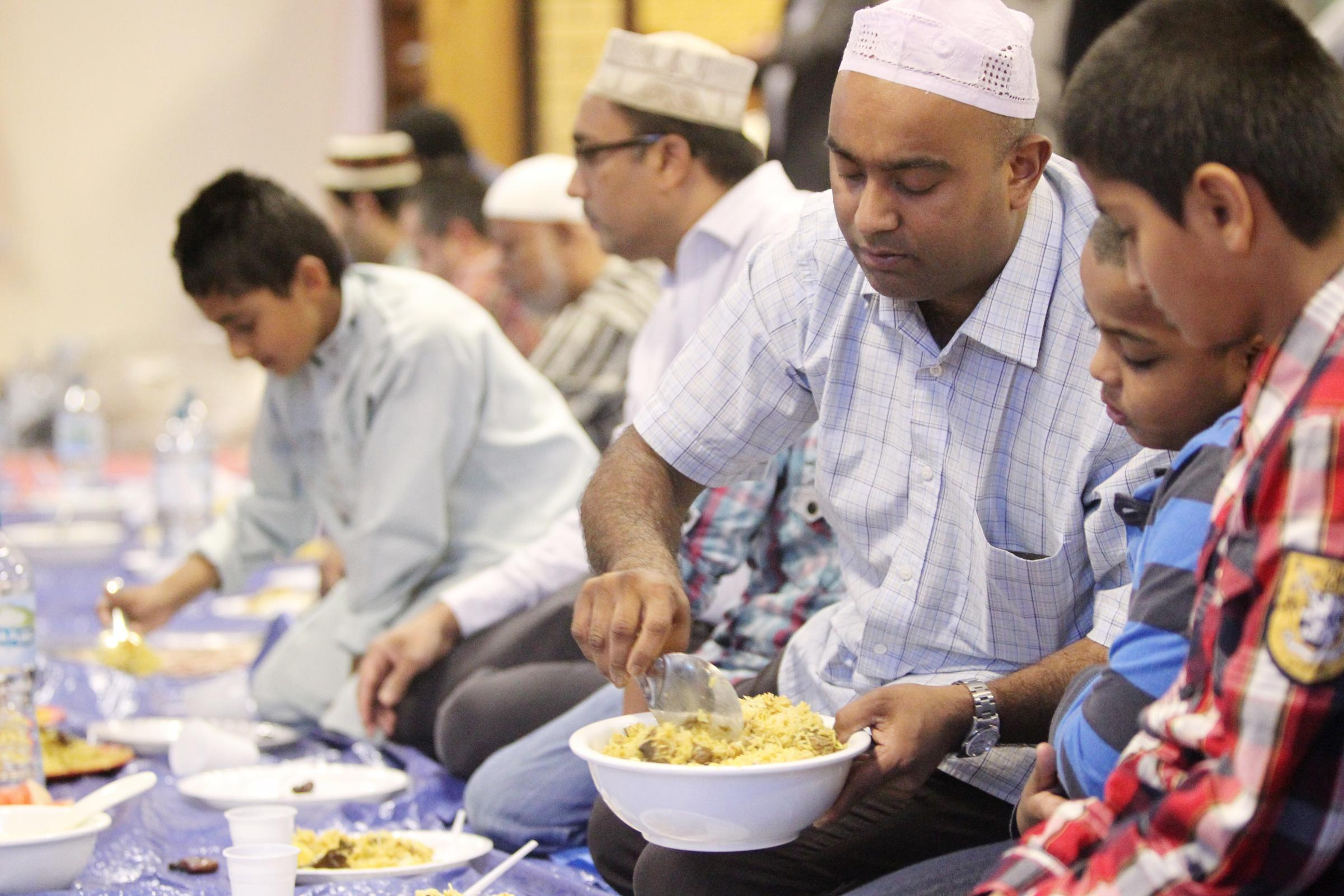 Families break the Ramadan fast at Medina Mosque in 2012