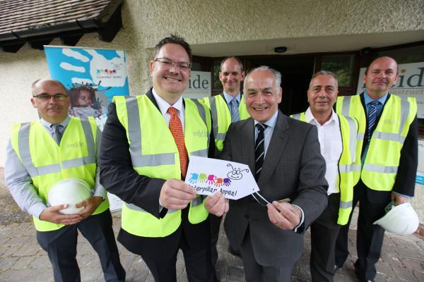 Caterpillar Appeal patron Alastair Stewart hands over the keys to Naomi House to Kevin Hayter, managing director of Reside Construction