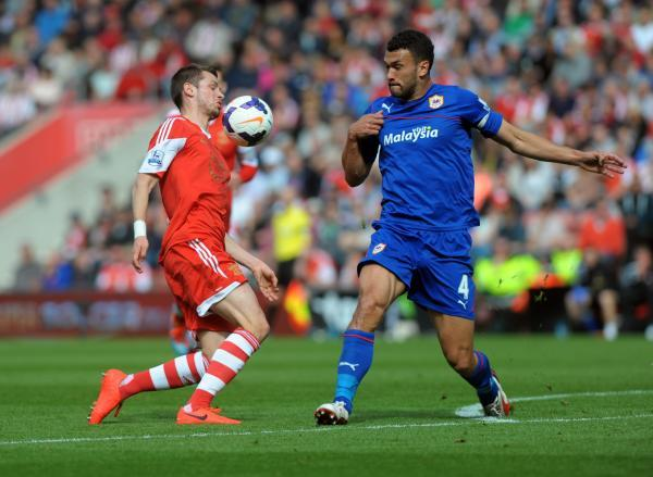 Steven Caulker, right, in action for Cardiff at St Mary's last season