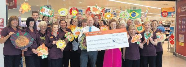 Staff at Sainsbury's Hedge End hand over a cheque to The Countess Mountbatten Hospice Charity.