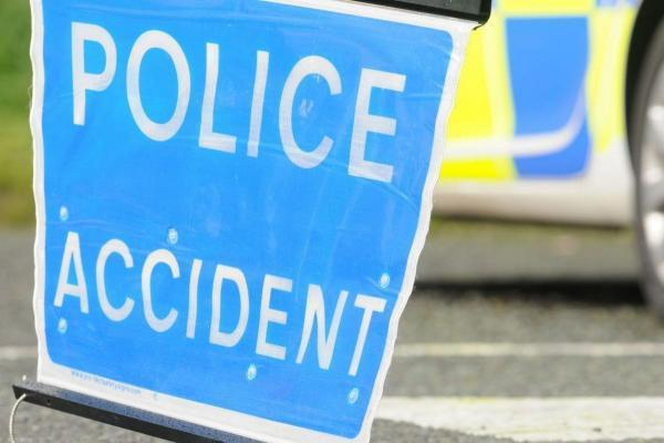Delays as car overturns on busy road