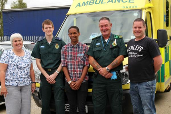 Sam Mangoro, centre, meets some of the paramedics who saved his life.