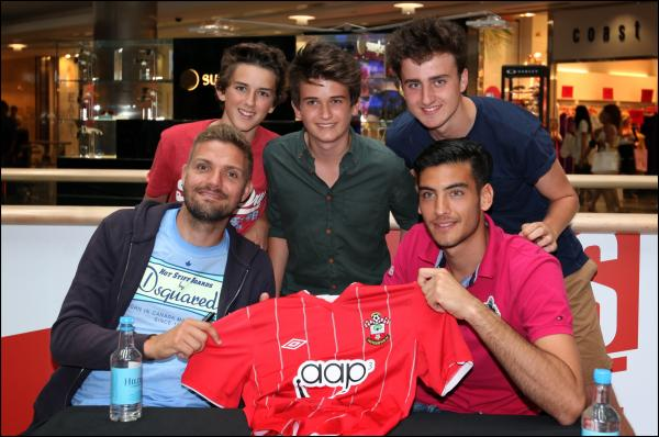 Saints players Jos Hooiveld and Paulo Gazzaniga met fans Reece (3) and Ethan (7) Harding.