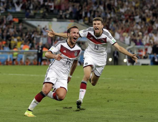 Daily Echo: Mario Gotze celebrates his extra time winner in the World Cup final