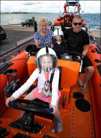 ALL ABOARD: Nicole (6) and Ollie (4) Weaver joined dad Dean and grandma Brenda on an RNLI RIB.