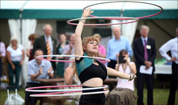 CIRCUS SKILLS: Amy 'Hooplovin' does her act at the launch.
