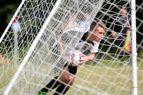 Josh Graham picks the ball out of the net after scoring Romsey's first goal