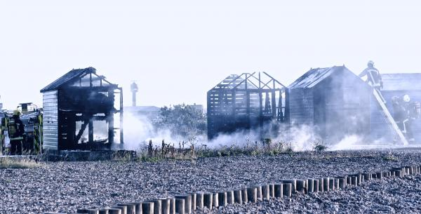Beach huts destroyed by fire