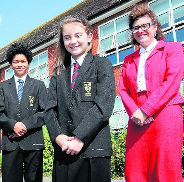 Rosie Randall and Robin Shepherd model the uniform with head teacher Jenny Pitman