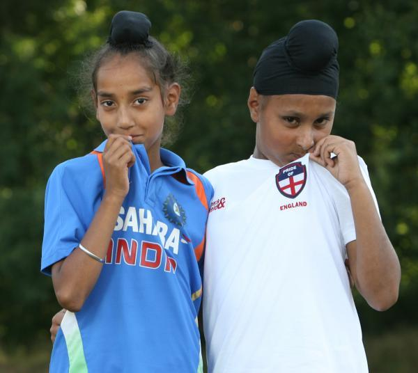 Harkirat Singh, left, and Balraj Singh show who they are supporting at the Test match