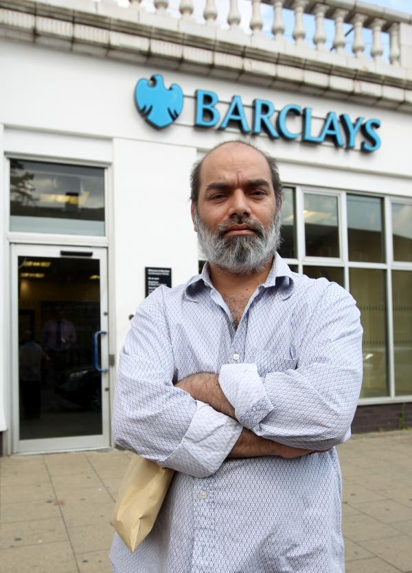 Salaur Rahman outside the bank where a thief stole thousands of pounds from him