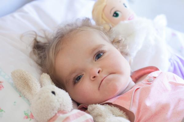 Little Evie is one in 168 million - and has defied the odds to survive